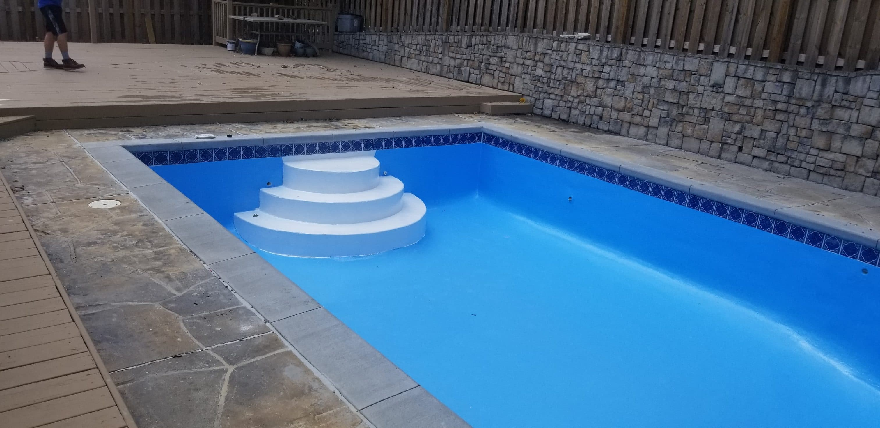 North Kansas City pool restoration with new waterline tile, coping and new paint