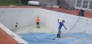 Titan Aquatics team getting ready for new epoxy paint in Pleasant Hill, MO pool.